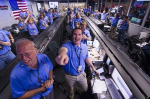 Laboratory team in the MSL Mission Support Area reacts after learning the the Curiosity rover has landed safely on Mars and images start coming in at the Jet Propulsion Laboratory on Mars, Sunday, Aug. 5, 2012 in Pasadena, Calif. Space