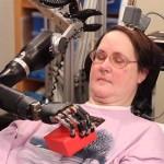 CYBORG FUTURE DRAWS CLOSER AS WOMAN CONTROLS ROBOTIC ARM WITH BRAIN IMPLANT