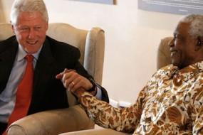 Bill-Clinton-Visits-Mandela-Awaken