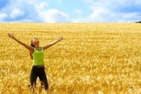 Happy-Woman-in-Field-Awaken