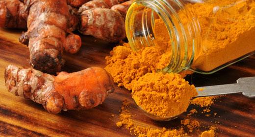 turmeric-roots-and-a-jar-of-turmeric-powder--awaken