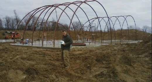 Building the largest underground and off the grid farm on for Earth berm construction