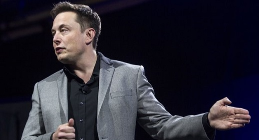 Elon Musk, CEO of Tesla Motors Inc., unveils the company's newest products, Powerwall and Powerpack in Hawthorne, Calif., Thursday, April 30, 2015. (AP Photo/Ringo H.W. Chiu)