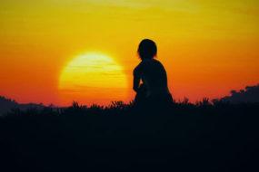 woman-watching-sunset-awaken
