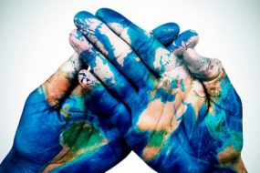 hands-patterned-world-map-awaken
