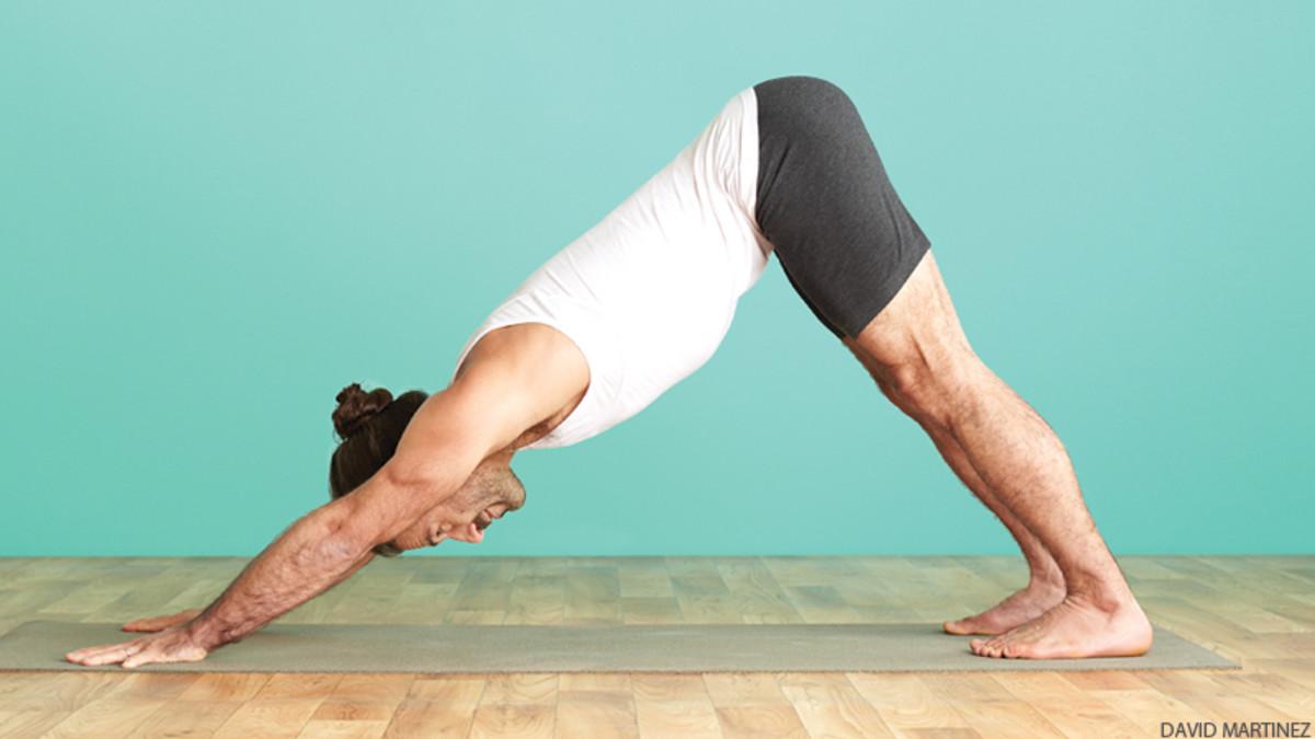 man-in-adho-mukha-svanasana-downward-facing-dog-yoga-pose-AWAKEN