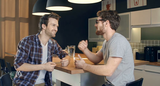 close-up-of-two-handsome-guys-talking-in-the-kitchen-awaken