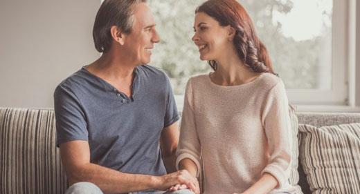 Happy-couple-talking-to-each-other-awaken