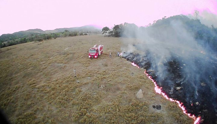 A drone photo released by the Corpo de Bombeiros de Mato Grosso on Tuesday shows brush fires burn in Mato Grosso state, Brazi