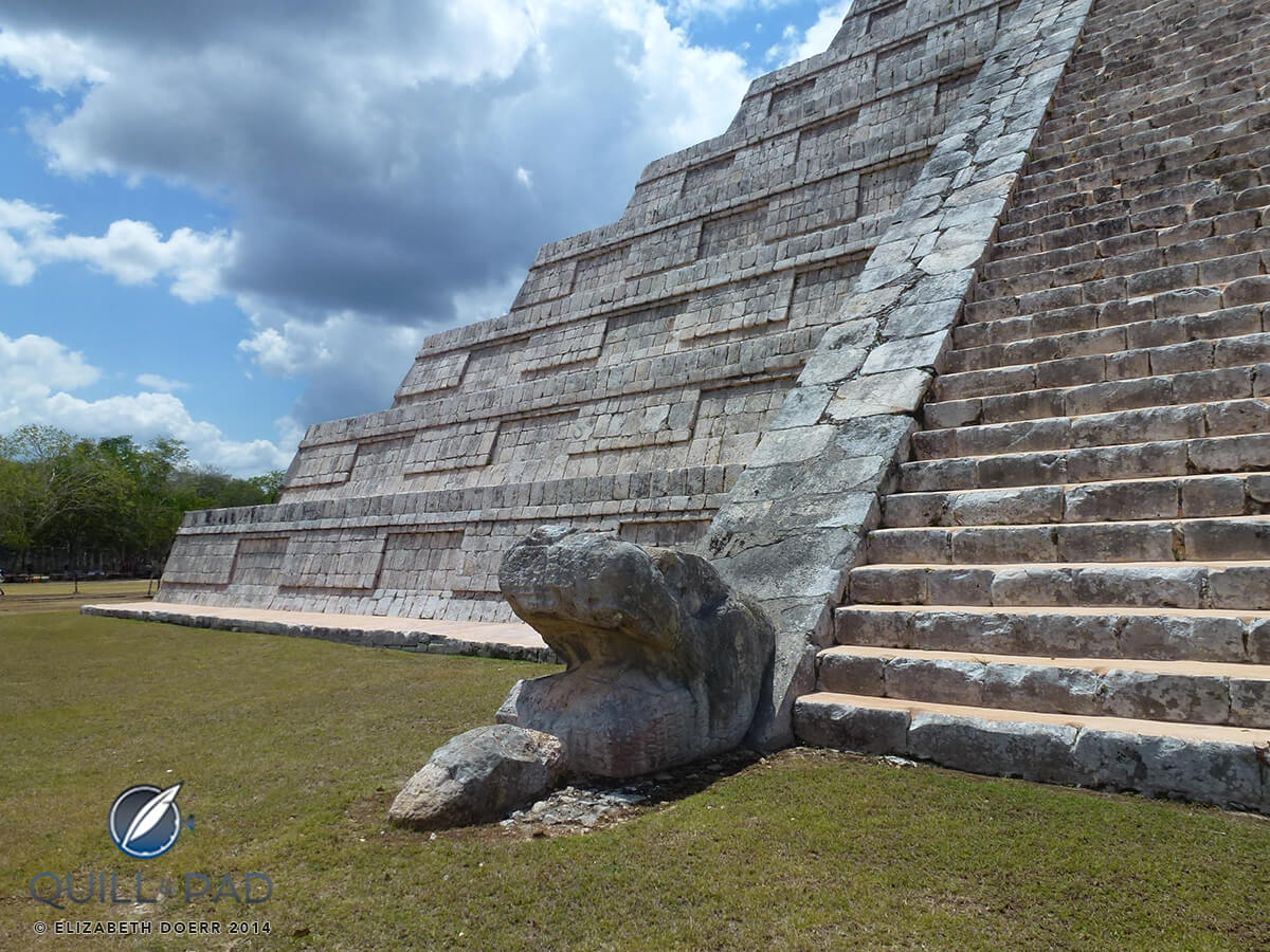 Serpent head at the bottom of the stairs of El Castillo at Chichen Itza
