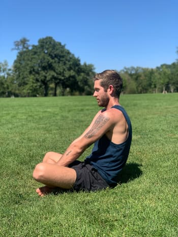 Exhale and round the back, so the back of the heart opens. Keep the chin parallel with the ground and continue for 90 seconds to three minutes. This exercise helps to harmonize our brainwaves, so they all work together.