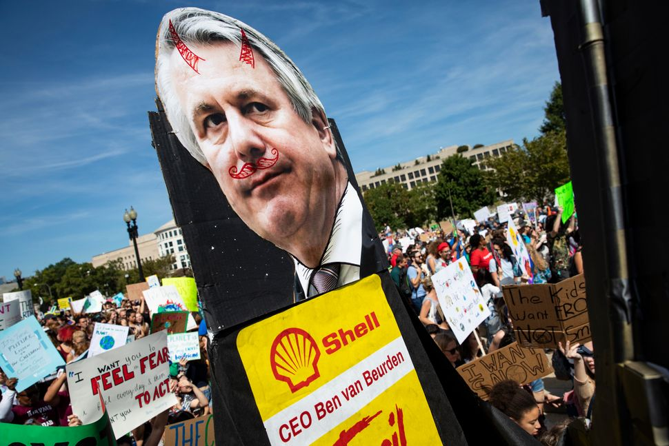 Youth carry along an effigy of Shell CEO Ben van Beurden for the Global Climate Strike protests on September...