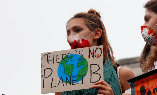Students demonstrate during a worldwide protest demanding action on climate change in Milan in