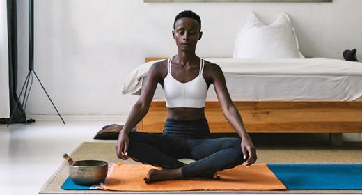 Black Woman Meditating Next To Singing Bowl-awaken