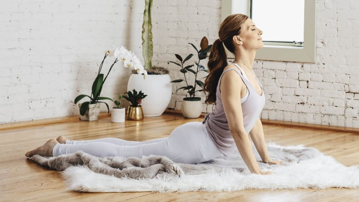Come onto your belly with your legs straight, feet together. Place your hands beneath your shoulders, and arch your spine from your neck to the base of your sacrum (at the base of your spine) until your arms are straight. Stay here for 2 seconds.See alsoKundalini 101: The Powerful Meaning of Sat Nam