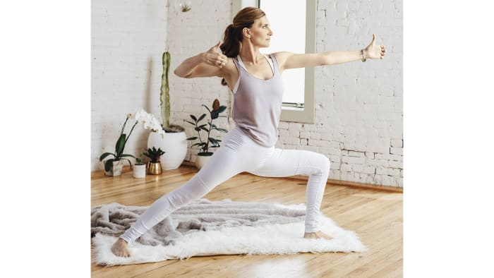 Stand up and take a wide stance with your left foot facing forward. Bend your left knee so it's directly over your toes. Turn your right foot inward so it's at a 45-degree angle with the front of your mat. Raise your left arm straight out in front of you, and make a gentle fist. Then begin drawing your right arm back with your elbow bent. Keep your eyes open, and focus forward on what you want to manifest in your life. From this position, straighten your left knee and then bend it again, continuing this motion for 2 minutes. Then, repeat on the other side.See also Kundalini 101: Try This Game-Changing Golden Milk Recipe at Home
