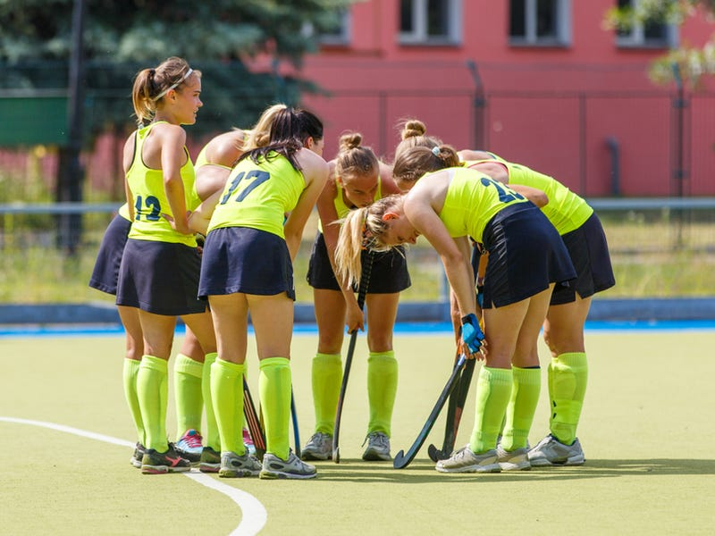 Women field hockey team before start of the game discussing strategy - Image