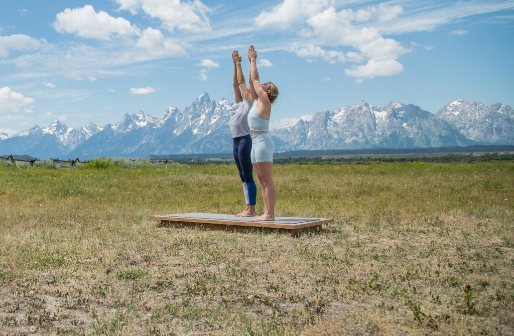Demonstrating good posture in mountain pose