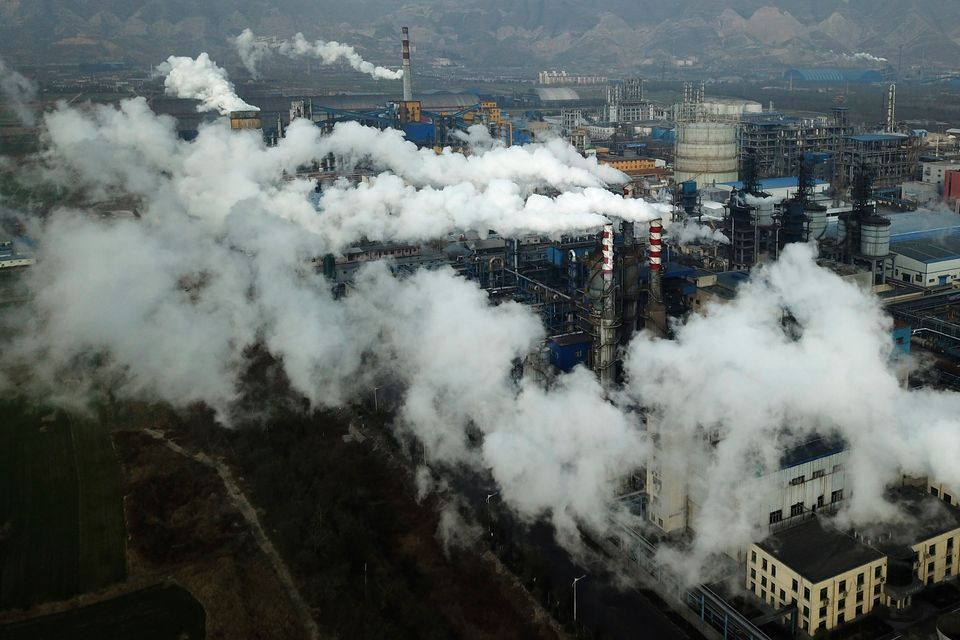 In this Nov. 28, 2019, photo, smoke and steam rise from a coal processing plant in central China's Shanxi