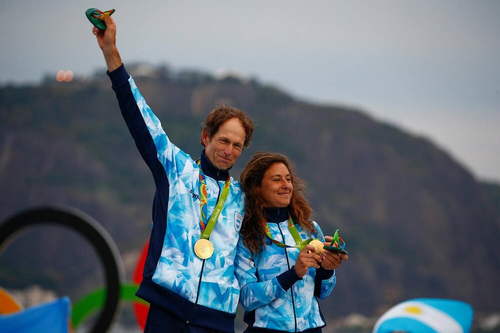 Cancer survivor Santiago Lange, with sailing partner Cecilia Carranza, winning gold medals for Argentina during the last Olympic Games. Image credit: Straits Times