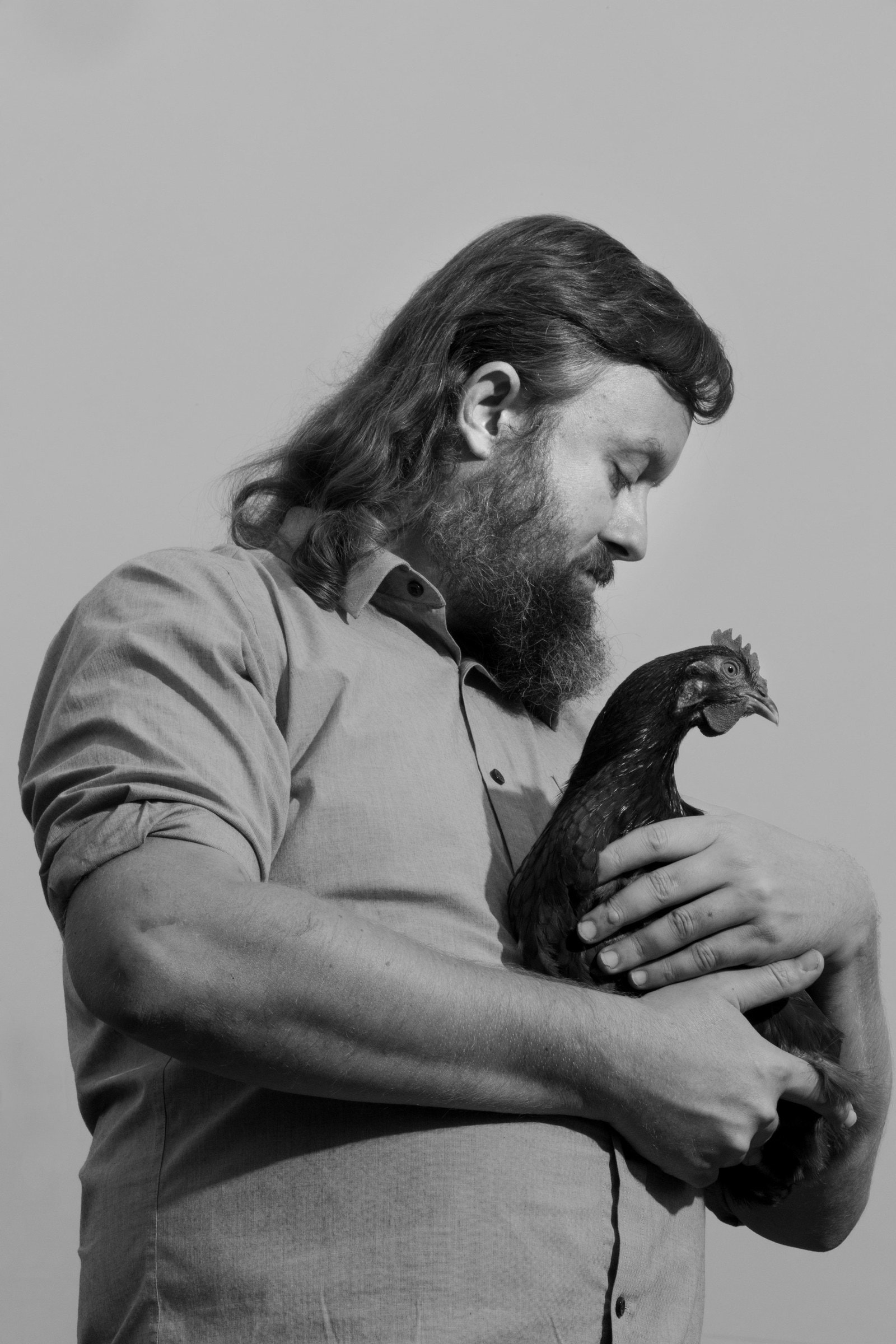 man holding a rooster