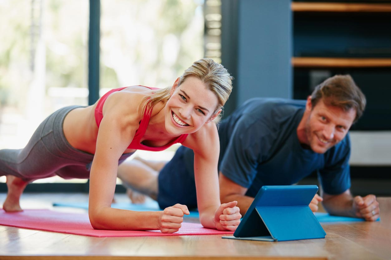 man and woman doing a plank