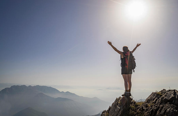 woman-exulting-on-a-mountaintop-awaken